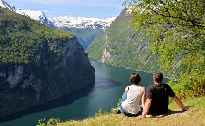 Nordic Visitor traveller Ivan Glaser with his daughter Nat overlooking Geirangerfjord in Norway.