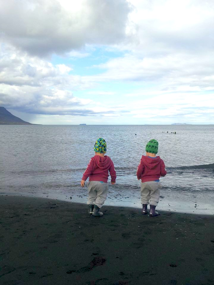 Þóra's twin sons exploring the black sands of Skagafjörður