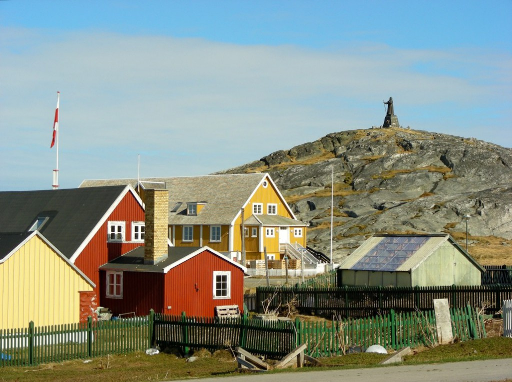 Colourful wooden houses dot Nuuk's shoreline.