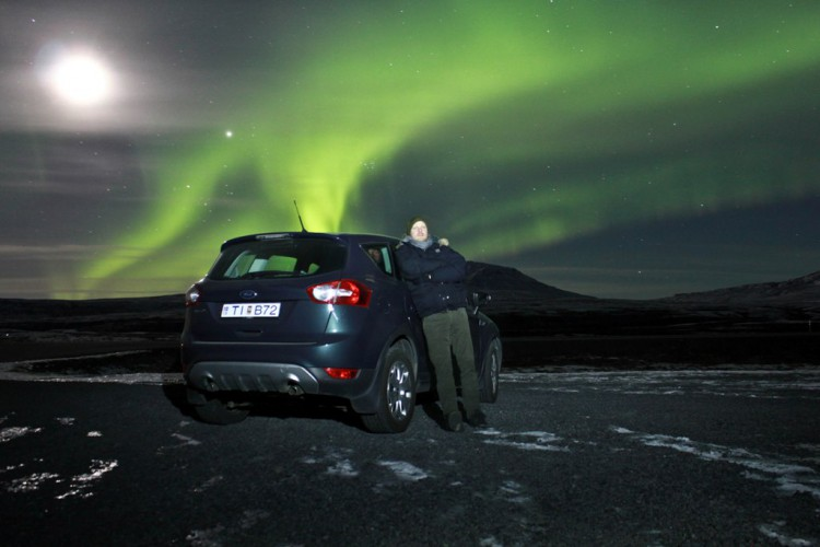 Nordic Visitor's founder, Ásberg Jónsson, checks out the aurora outside Reykjavík.