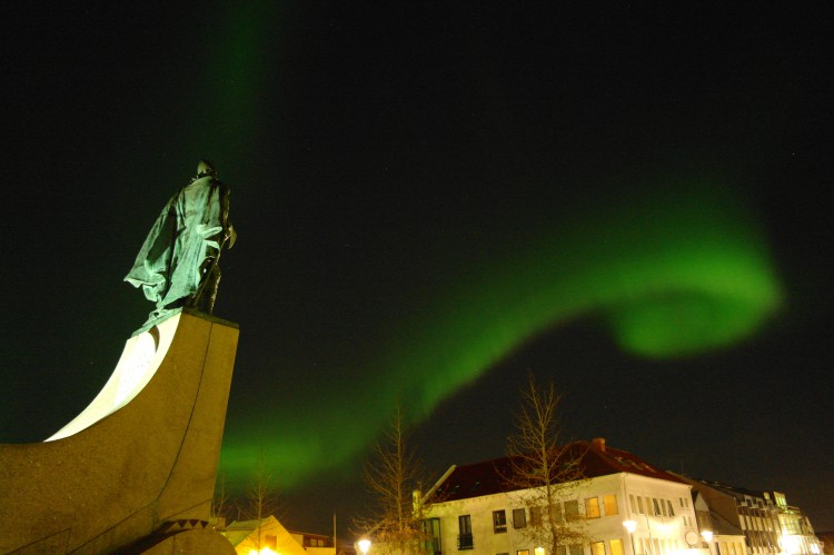 A emerald swirl of northern lights over central Reykjavík. Photo taken by Nordic Visitor employee Marco Fugallo.