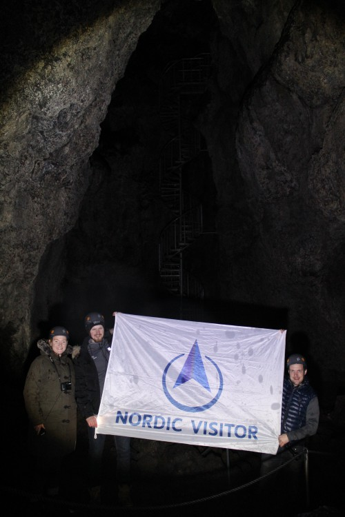 Catharine, Þór and Ævar stop for a quick photo op in the deepest point of Vatnshellir cave.
