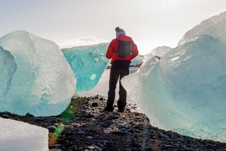 Andrea meanders between large icebergs from the Jökulsárlón glacier lagoon. (Photo by Michael Howe)