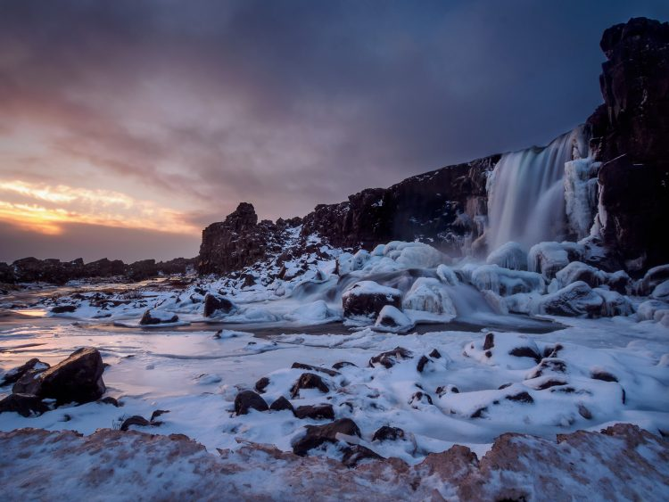 South Iceland waterfall in snow cover