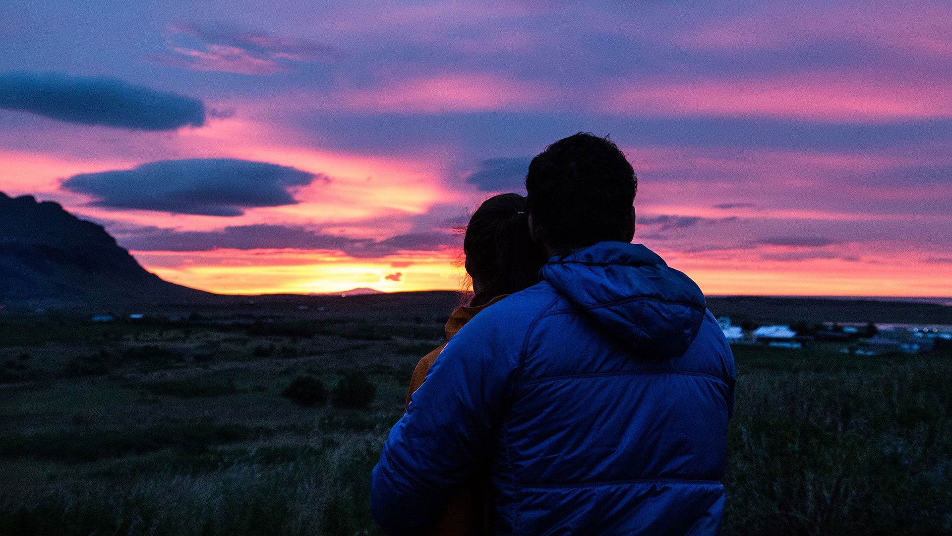 Couple under the midnight sun in iceland