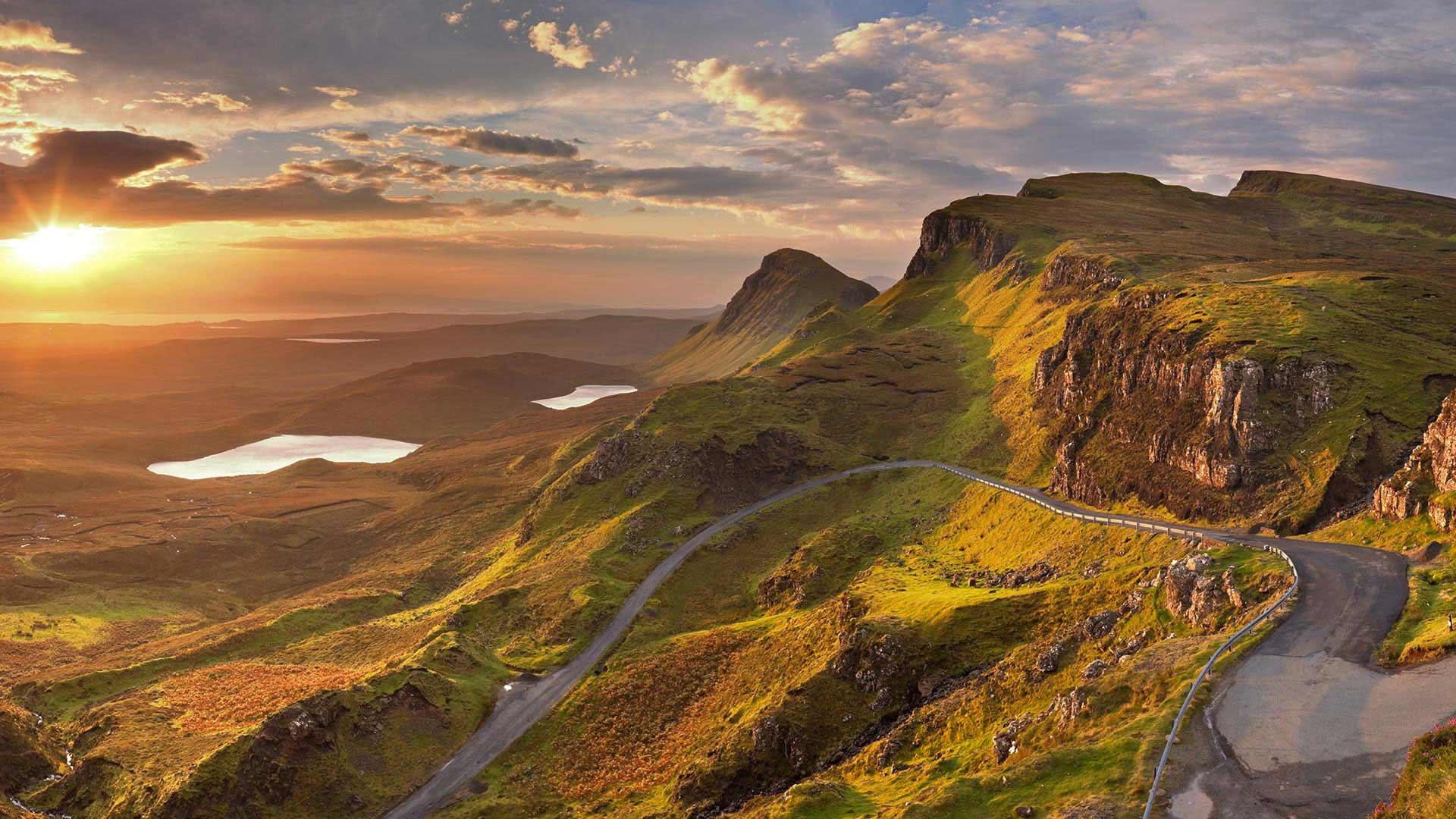 sun rising over quiraing rock formation