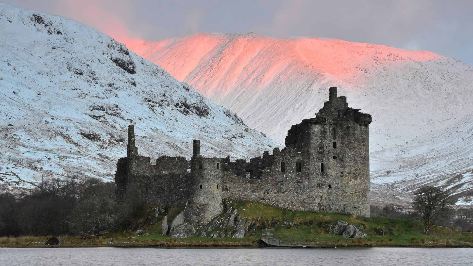 sunset over kilchurn castle in winter