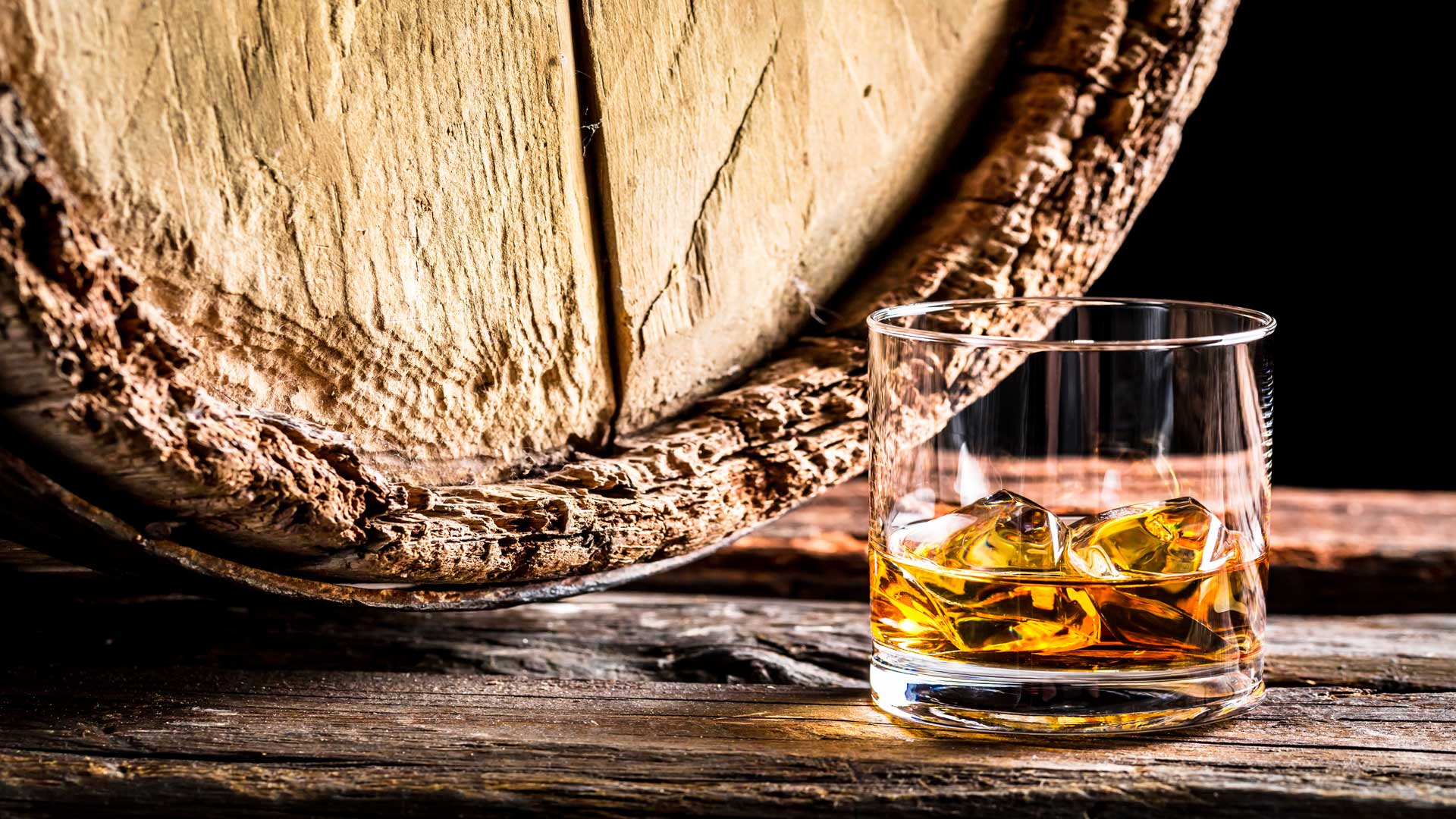 barrel and glass of whisky